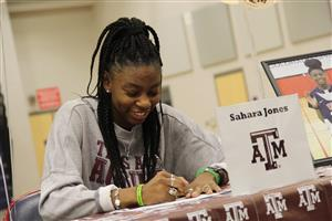 Sahara Jones signs scholarship