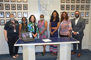 The JISD Board including Jennifer Rodriguez on computer screen sign resolution