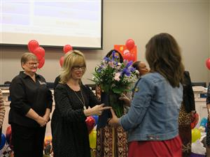 Ms. Cardenas being recoginzed as Distinguished Educator